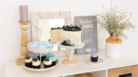 Photo for Birthday party. Boho candy bar with cake, cupcakes and different sweets. Confectionery concept - Royalty Free Image