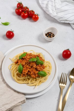 Photo for Italian pasta with meat, tomato sauce and vegetables. Bolognese with basil - Royalty Free Image