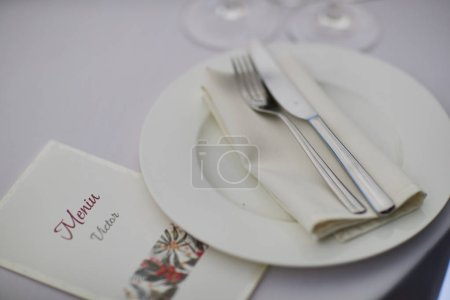 cutlery plates and glasses on