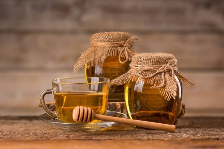 a jar of honey and a spoon