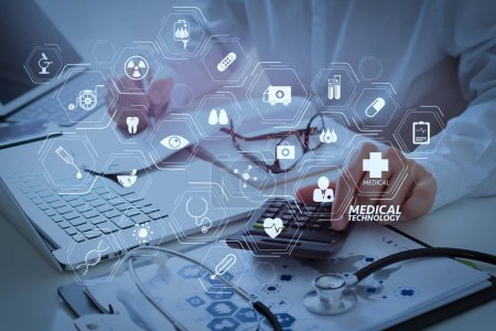 Photo for Modern VR with medical technology diagram concept.Healthcare costs and fees concept.Hand of smart doctor used a calculator for medical costs in modern hospital. - Royalty Free Image