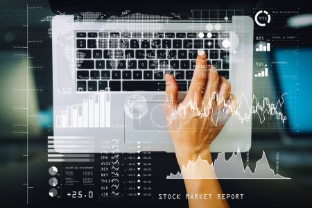 Investor analyzing stock market report and financial dashboard with business intelligence (BI), with key performance indicators (KPI).top view of businessman typing keyboard with laptop computer.
