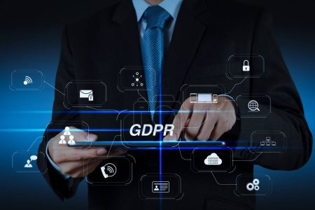GDPR. Data Protection Regulation with Cyber security and privacy virtual diagram.businessman hand using tablet computer