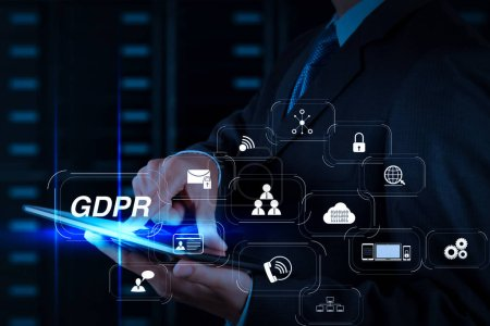 GDPR. Data Protection Regulation with Cyber security and privacy virtual diagram.businessman hand using tablet computer and server room background