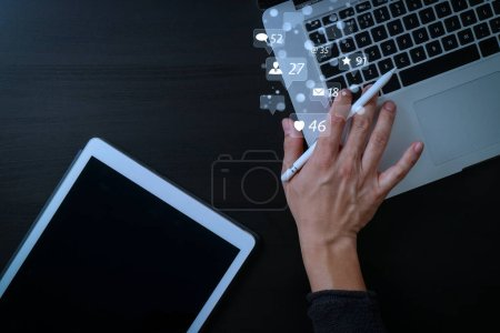 Photo for Social media and Marketing virtual icons screen concept.cyber security internet and networking concept.Businessman hand working with laptop computer and digital tablet - Royalty Free Image