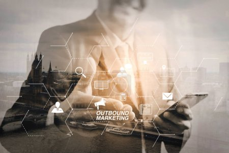 Outbound marketing business virtual dashboard with Offline or interruption marketing.Double exposure of success businessman open his hand with London building,city,river,Bigben,front view,filter effect