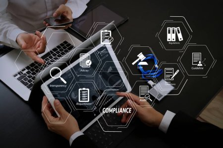 Compliance Virtual Diagram for regulations, law, standards, requirements and audit.co working team meeting concept,businessman using smart phone and digital tablet and laptop computer and name tag in modern office