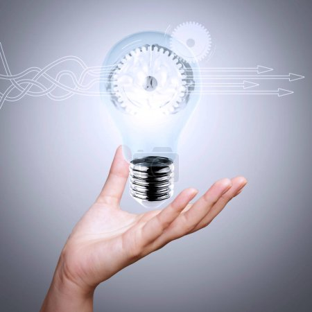Thinking about structuring virtual diagram of business process with solutions. human brain in a lightbulb as creative concept