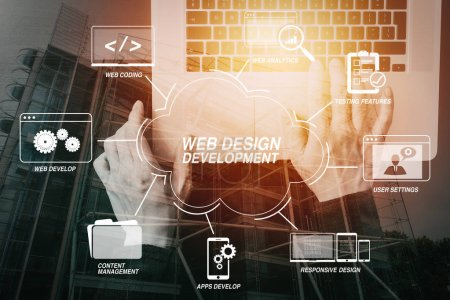 Developing programming and coding technologies with Website design in virtual diagram.cyber security internet and networking concept.Businessman hand working with laptop computer with buildings exposure