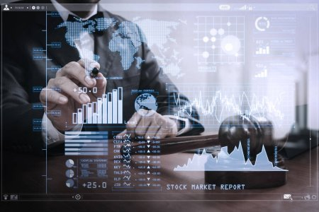Photo for Investor analyzing stock market report and financial dashboard with business intelligence (BI), with key performance indicators (KPI).justice and law concept.Male judge in a courtroom with the gavel,working with smart phone. - Royalty Free Image