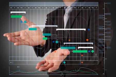 Project manager working and update tasks with milestones progress planning and Gantt chart scheduling virtual diagram.business man with an open hand as showing something concept.