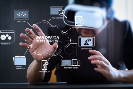 Developing programming and coding technologies with Website design in virtual diagram.businessman wearing virtual reality goggles in modern office with Smartphone using with VR headset