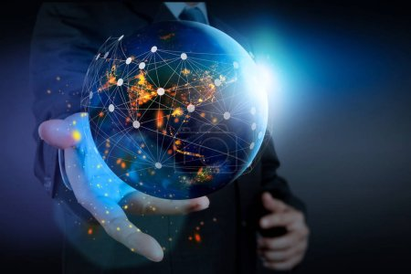 Hand holding Global world telecommunication network connected around planet Earth for internet and worldwide communication technology fabout finance with blockchain and IoT,Elements of this image furnished by NASA