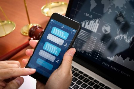 Chatbot conversation with smartphone screen app interface and artificial intelligence technology processing virtual assistant with customer support information,Lawyer hand holding mobile phone.
