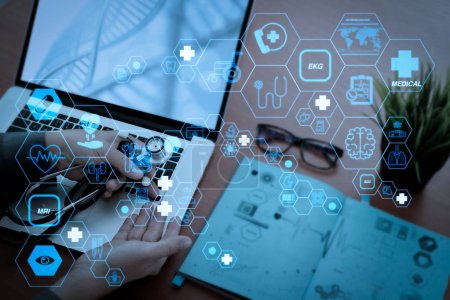 Health care and medical technology services concept with flat line AR interface.Medicine doctor hand working with modern computer and digital medical layers on wooden desk as medical concep