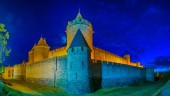 Night view over illuminated fortification of Carcassonne, Franc