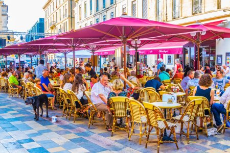 NIMES, FRANCE, JUNE 20, 2017: People are dinning in the center of Nimes, Franc