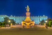 Night view of Equestrian statue of Felipe IV at Plaza de Oriente in Madrid, Spain with the royal palace at backgroun