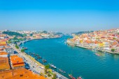 View of Porto stretched alongside a bend of river Douro, Portugal.