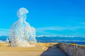 ANTIBES, FRANCE, DECEMBER 30, 2017: Statue called Le Nomade situated in Antibes, France