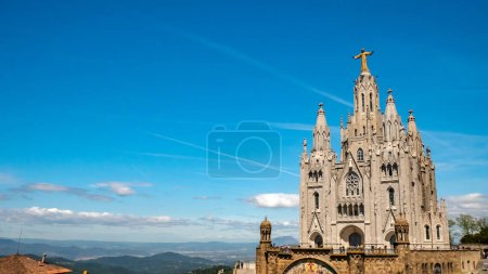Photo for Tibidabo Cathedral. Temple of the Sacred Heart of Jesus at Mount Tibidabo. Barcelona, Spain. Blue sky with cloud of spring day. Famous landmark in Catalonia. - Royalty Free Image