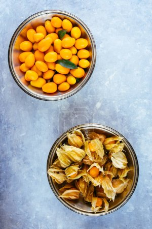 Photo for Top view of ripe delicious Kumquats on concrete table - Royalty Free Image