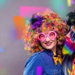Happy man and woman wearing color wigs with party ...