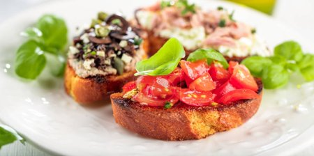 bruschetta, slices of toasted baguette garnished with basil