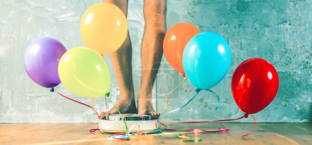Bathroom scales with colorful balloons. Slimming concept