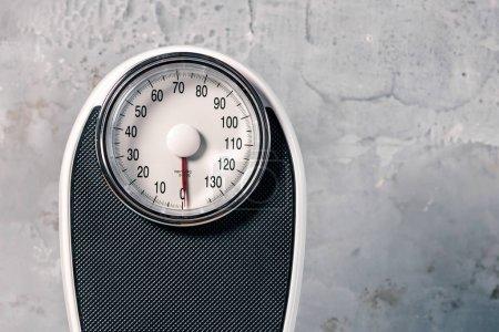 Bathroom scale isolated on grey background