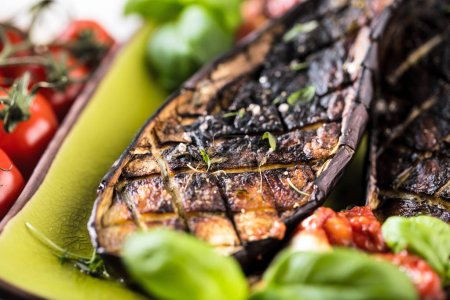 Photo for Grilled glazed eggplants on black background, top view, copy space - Royalty Free Image