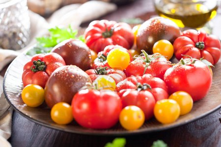 Photo for Colorful tomatoes, red , yellow , orange , green on vintage wooden background - Royalty Free Image