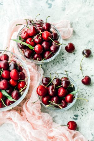 Photo for Top view of delicious fresh ripe cherries in glass bowls - Royalty Free Image