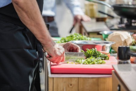 Photo for Cropped shot of chef cooking in restaurant kitchen - Royalty Free Image