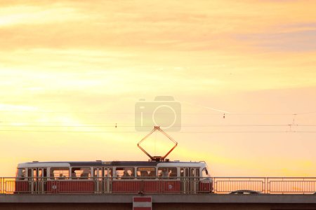 Photo for Tram on bridge at sunset in Prague, Czech Republic - Royalty Free Image