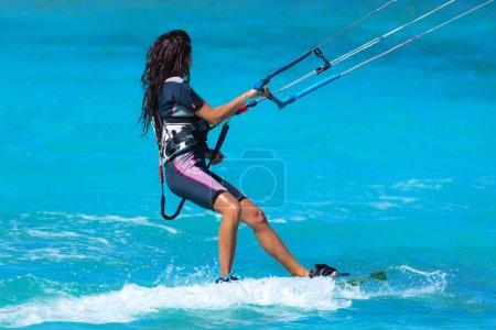 Photo for Kiteboarders kitesurfers athletes performing kitesurfing kiteboarding tricks - Royalty Free Image