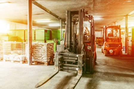 Photo for Warehouse man worker with forklift. - Royalty Free Image
