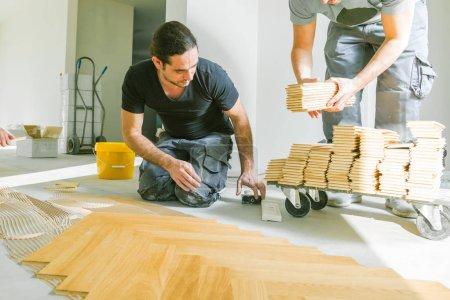 Foto de Male workers working during home renovation. Repair, building and home concept - Imagen libre de derechos