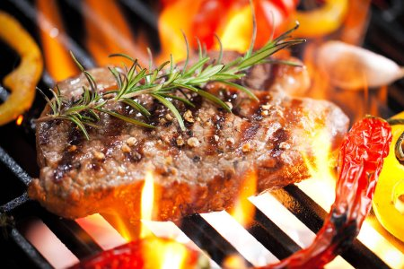 Photo for Close-up view of delicious steak with rosemary and vegetables on grill - Royalty Free Image