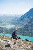 hiker standing on Besseggen ridge in Jotunheimen National Park, Norway