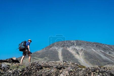 Photo for Traveler hiking on Besseggen ridge in Jotunheimen National Park, Norway - Royalty Free Image