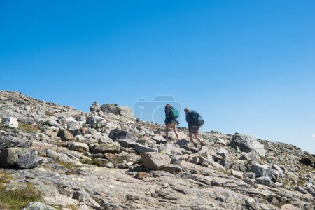 couple hiking on Besseggen ridge in Jotunheimen National Park, Norway