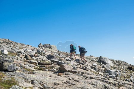 Photo for Couple hiking on Besseggen ridge in Jotunheimen National Park, Norway - Royalty Free Image