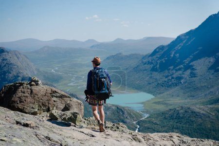 man hiking on Besseggen ridge over Gjende lake in Jotunheimen National Park, Norway