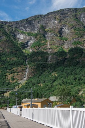 houses and bridge in Flam village near beautiful mountains, Aurlandsfjord (Aurlandsfjorden), Norway