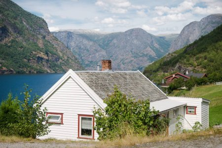 beautiful wooden houses in Flam village at majestic Aurlandsfjord (Aurlandsfjorden), Norway