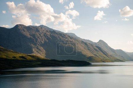 beautiful mountains covered with green vegetation and majestic Gjende lake, Besseggen ridge, Jotunheimen National Park, Norway