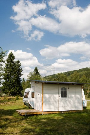 TRYSIL, NORWAY - 26 JULY 2018: parked trailer near forest and mountains at largest ski resort tryisl in Norway