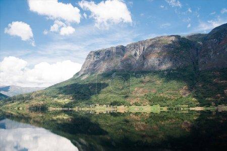 Photo for Mountain reflecting in lake water, Hallingskarvet National park, Norway - Royalty Free Image