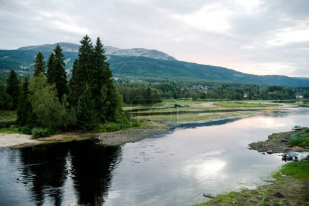 Photo for Aerial view of river and green mountains on background, Trysil, Norway's largest ski resort - Royalty Free Image